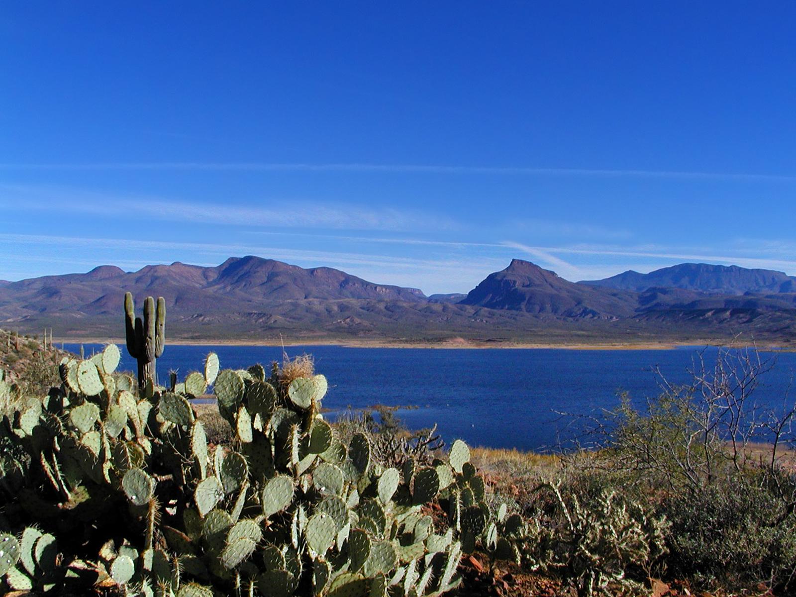 Scenery around a dark blue lake surface.