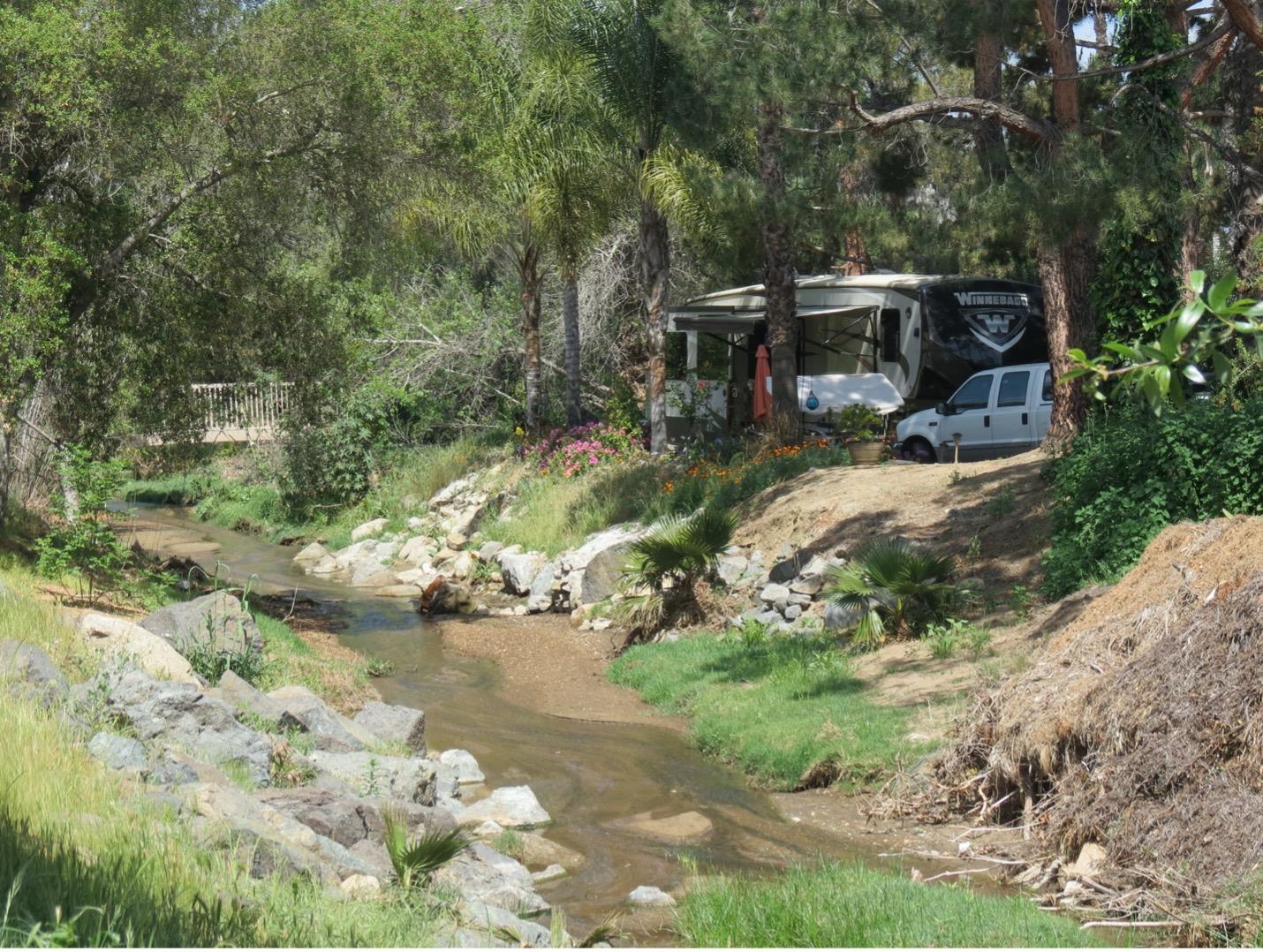 RV site overlooking stream.