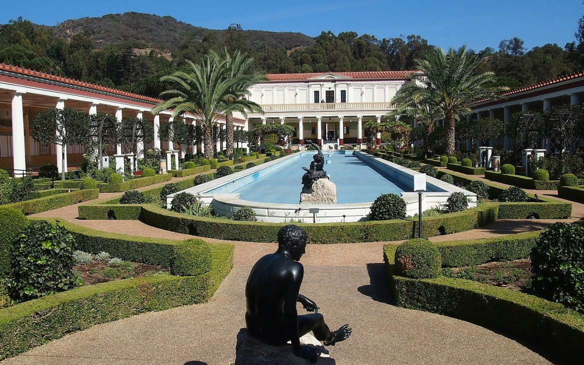 Long pool with statues at Getty Villa in Malibu