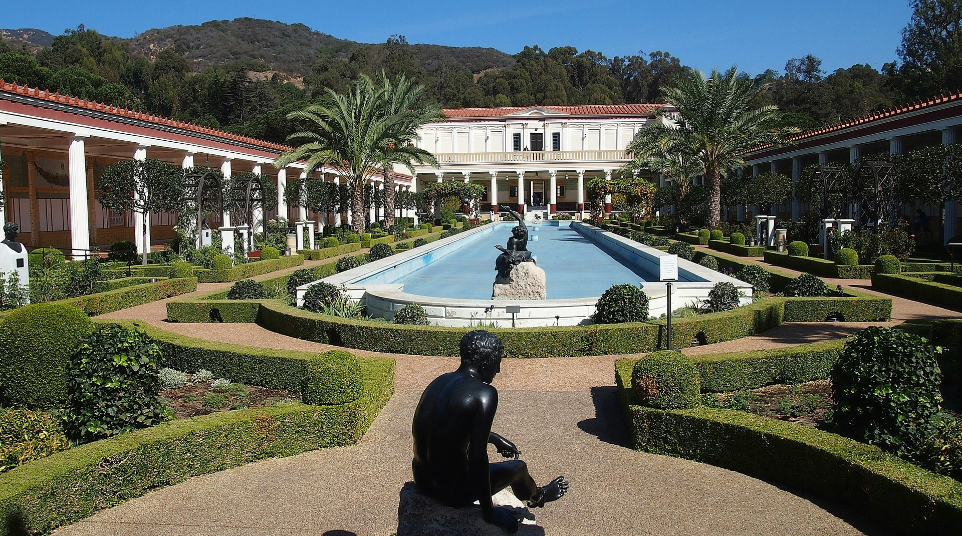 Long pool with statues at Getty Villa
