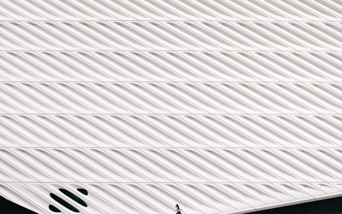 person running in front of white wall photo at The Broad