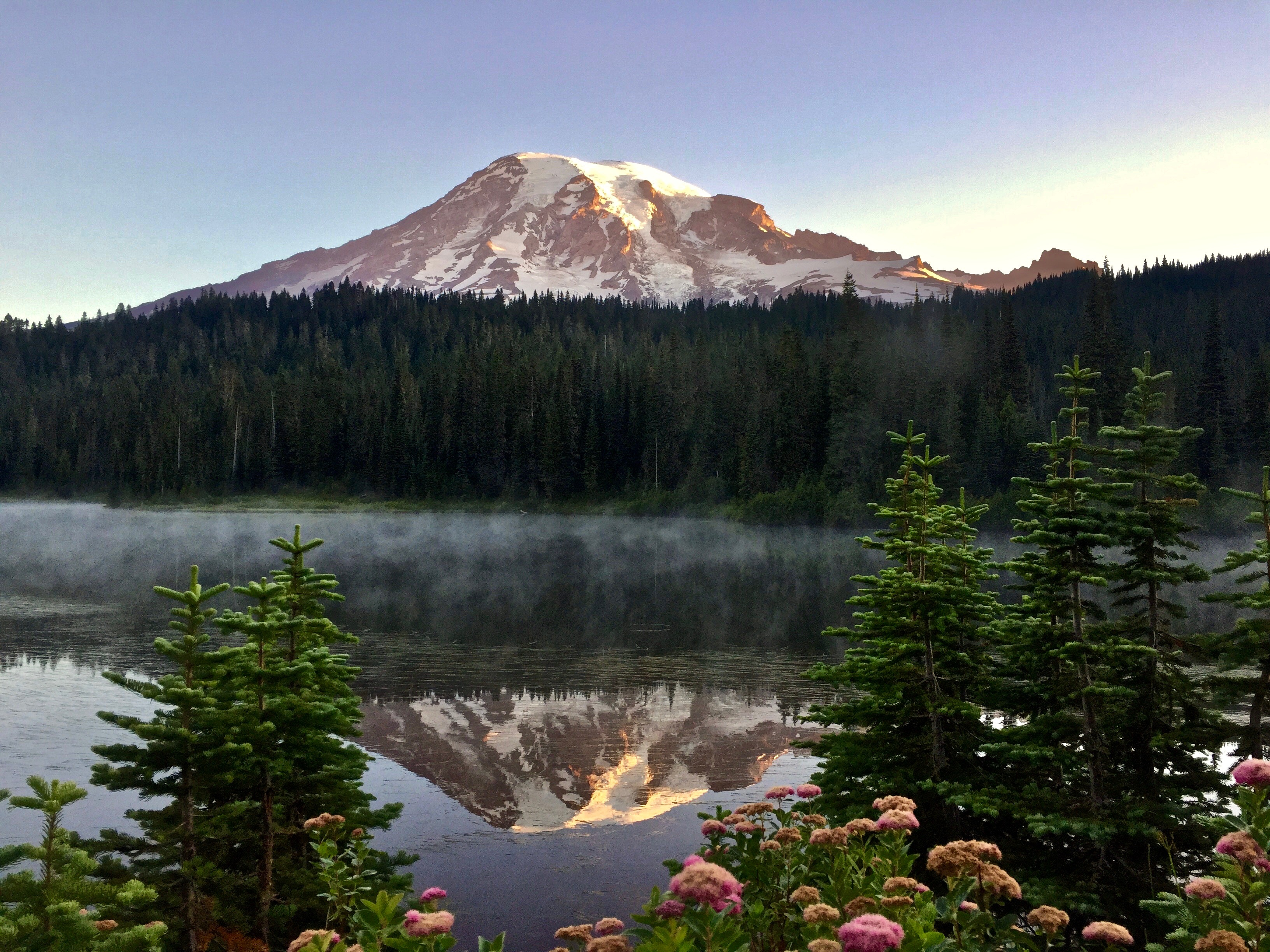 Mountain reflected majestically on the surface of a serene lake.