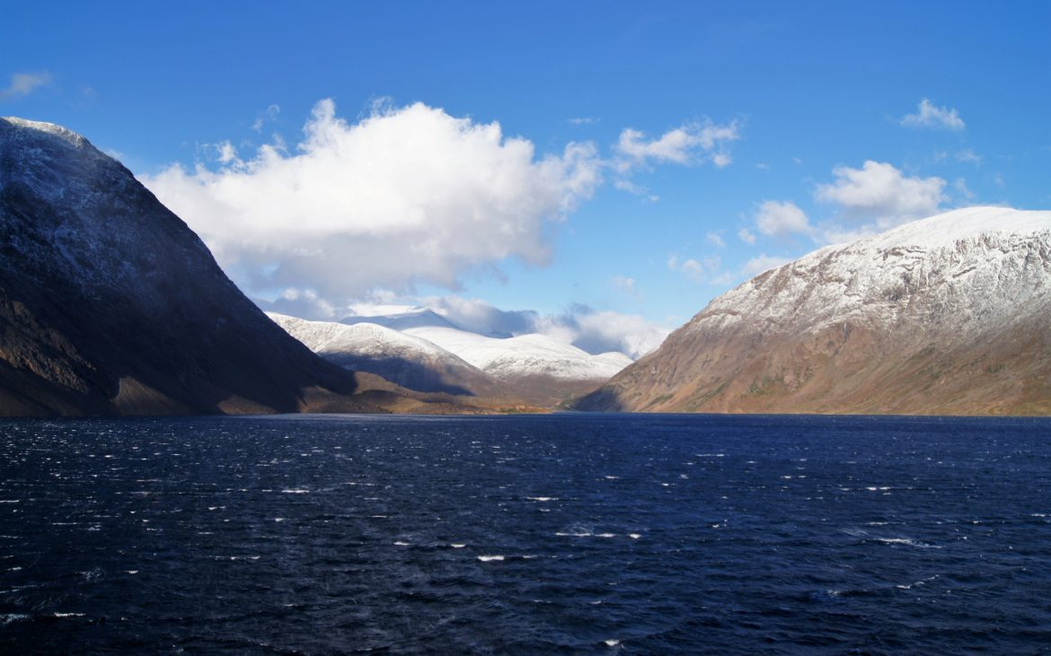 snowcapped mountains shot from the water, Torngat Mountains