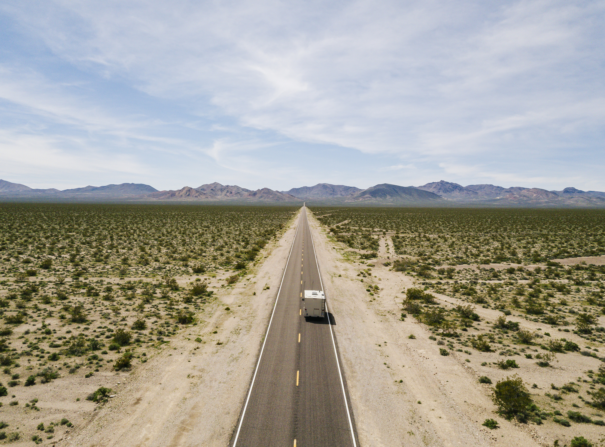 Aerial view of a motorhome driving on a highway in the desert of USA California