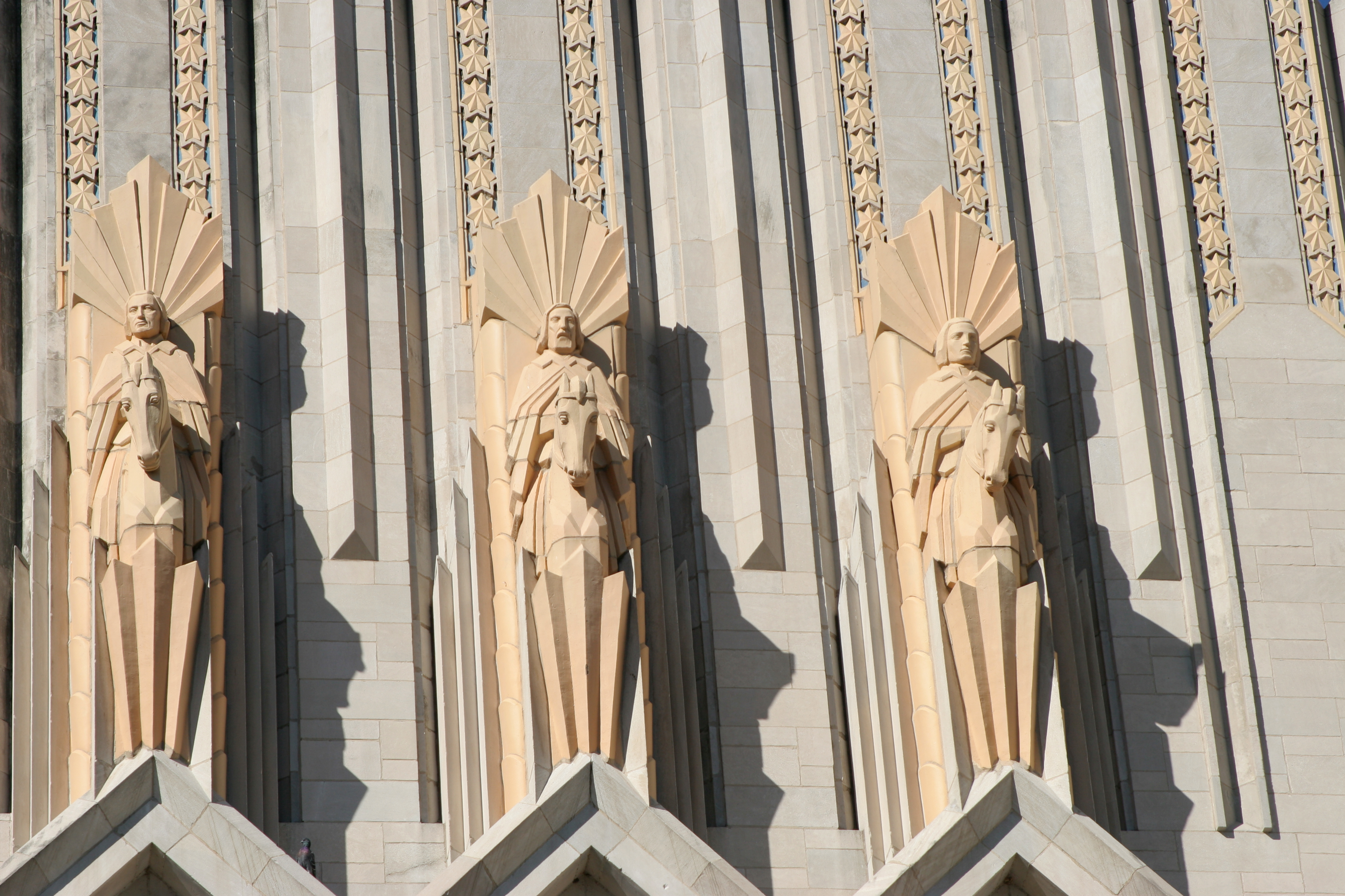 Ornate statues line the wall of a Methodist church.