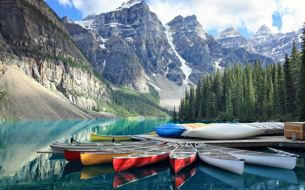 Canoes on a jetty at Moraine lake, Banff national park in the Rocky Mountains, Alberta, Canada