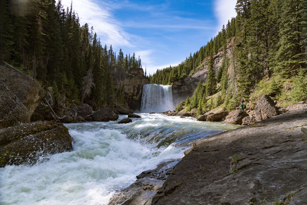 Northeast of Grande Prairie —A waterfall thunders in a river canyon.