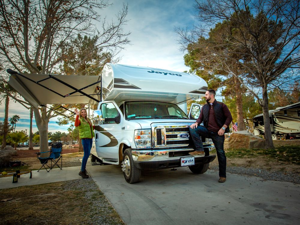 Two campers with a Class C motorhome.