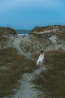 Woman sitting on beach trail in Roanoke