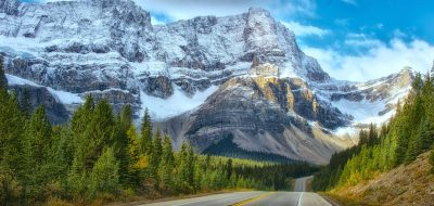 Highway leading to snowy mountain in Banff Canada
