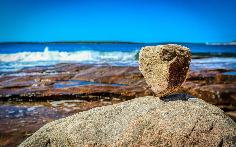 Rock balancing on bigger rock at Mount Desert Island, Acadia National Park, Maine