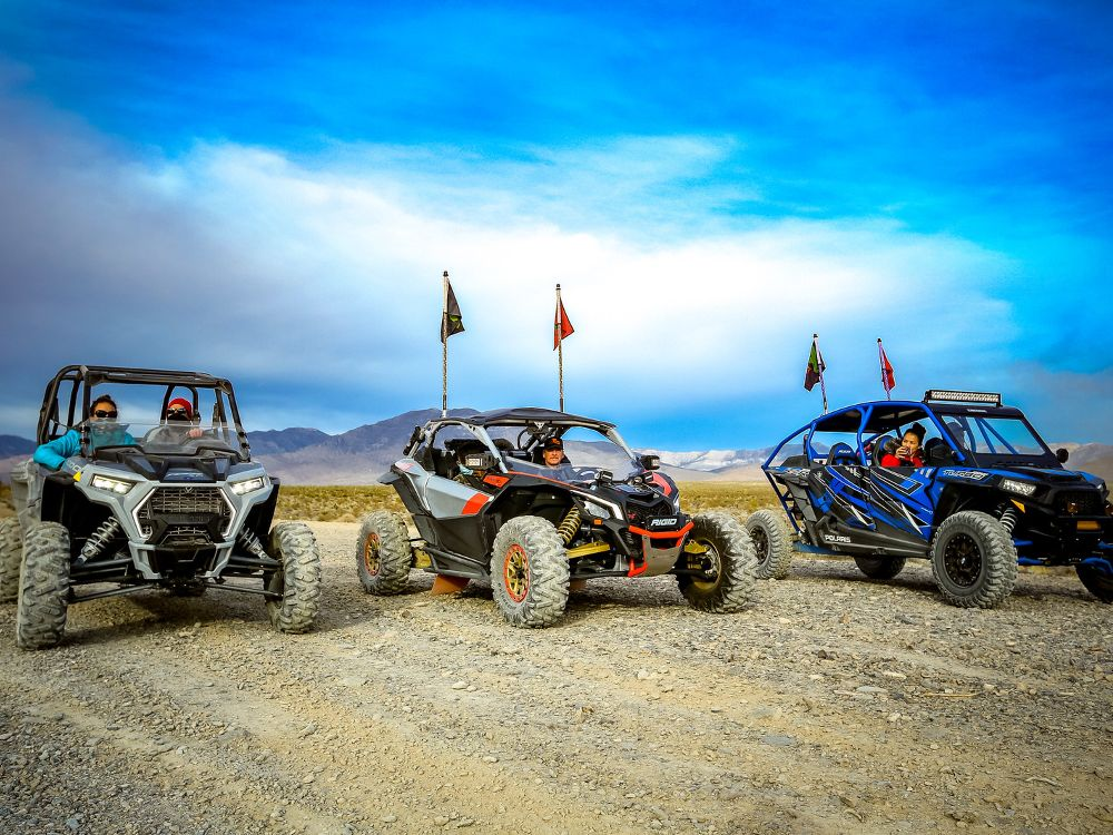 Three ATVs lined up and ready to go.
