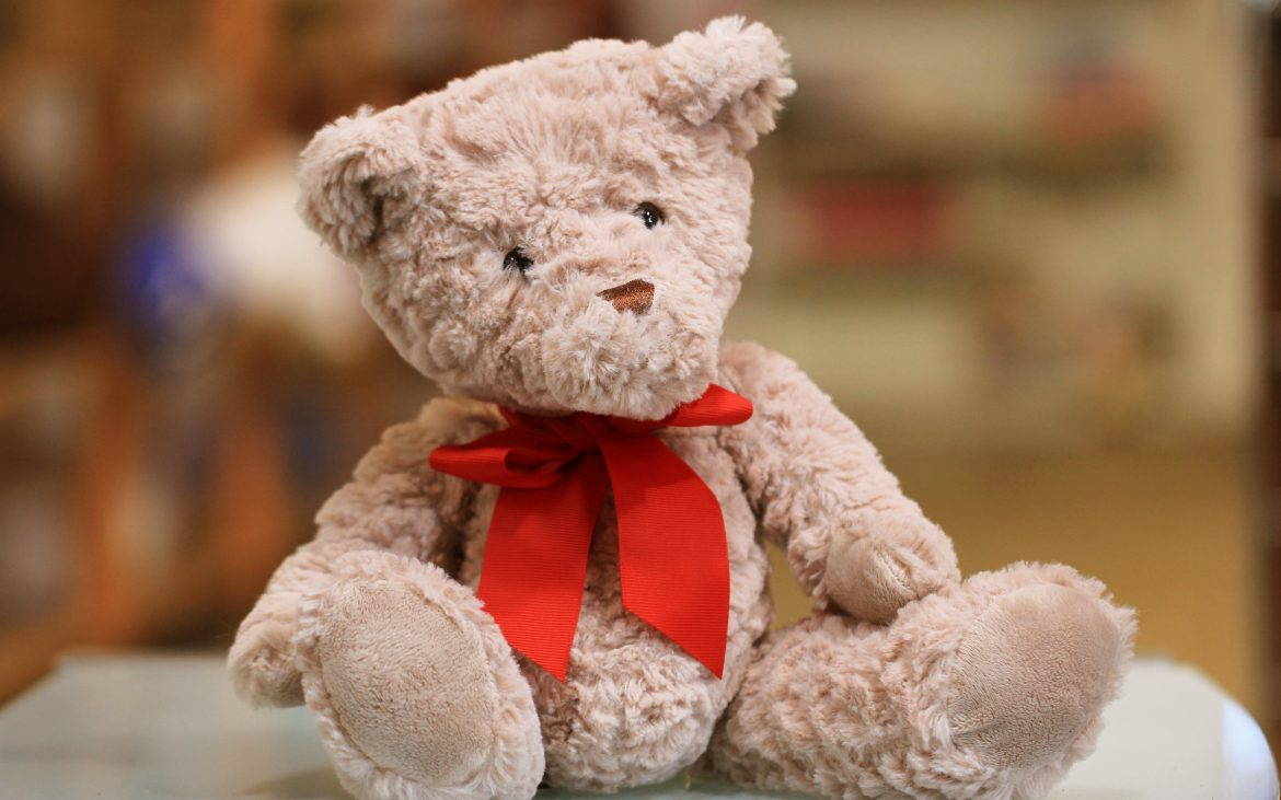 Stuffed bear with red bow