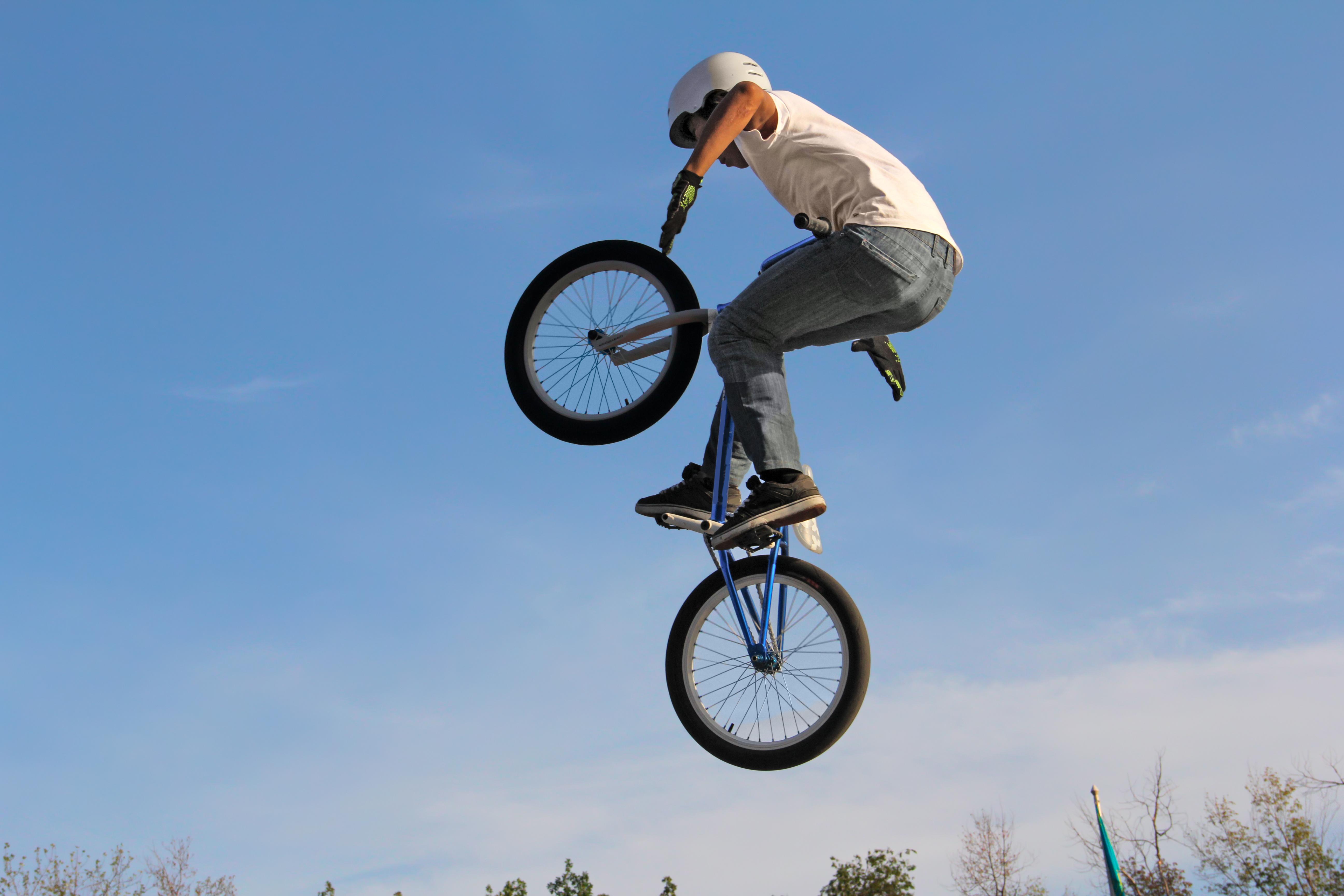 A boy gets air on a BMX bike.