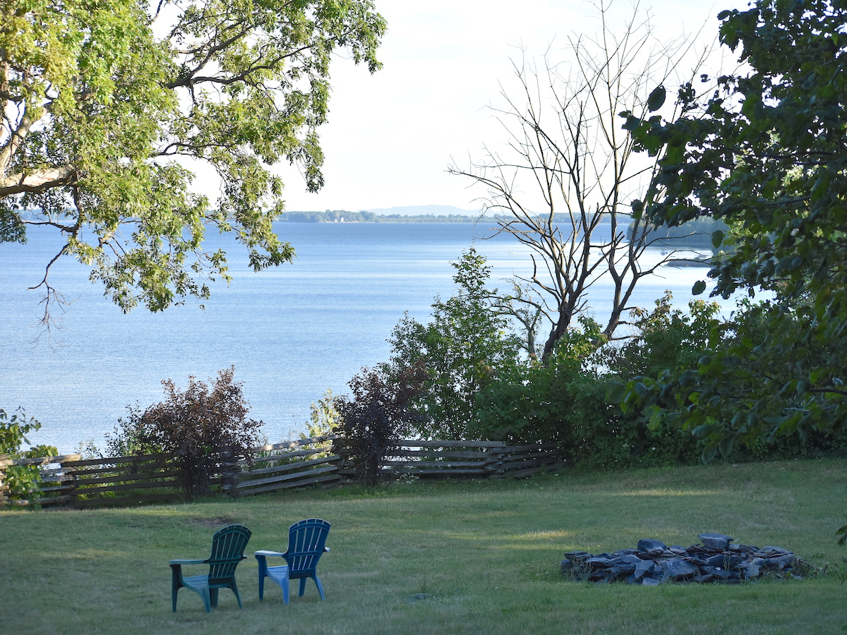 Best of Vermont's Recreation Opportunities — A firepit and adirondack chairs facing a fast lake.