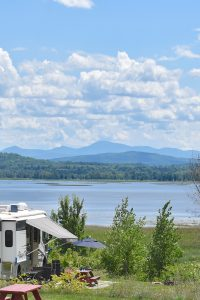 Best of Vermont's Recreation Opportunities — RV parked facing a vast lake.