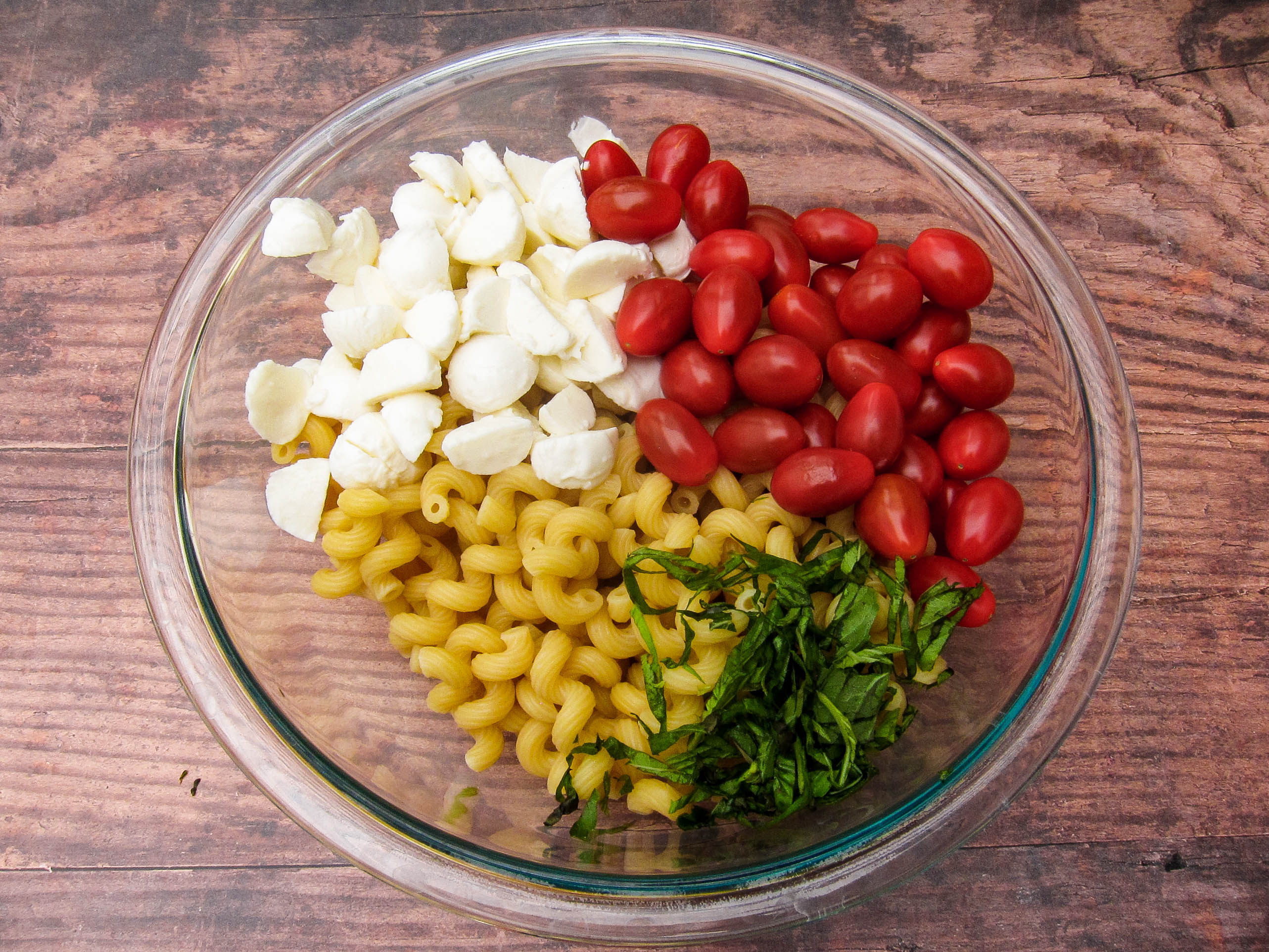 Salad ingredients in a bowl unmixed