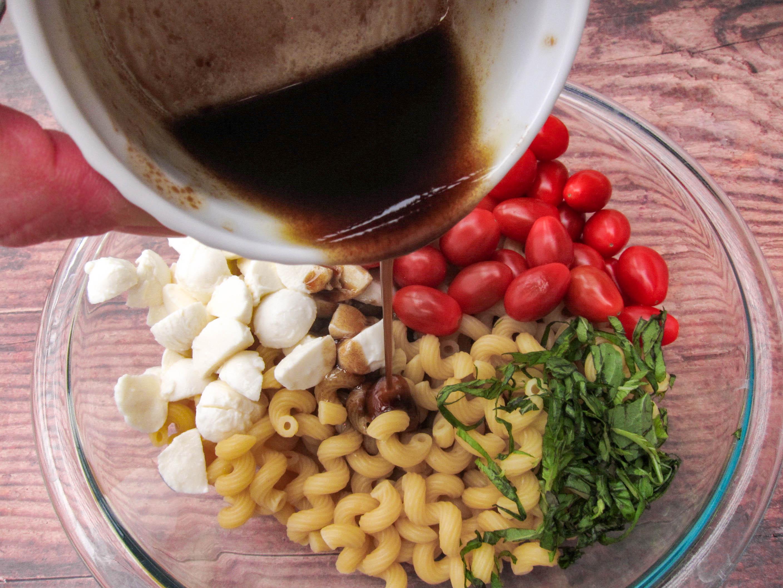 Pouring vinaigrette into salad