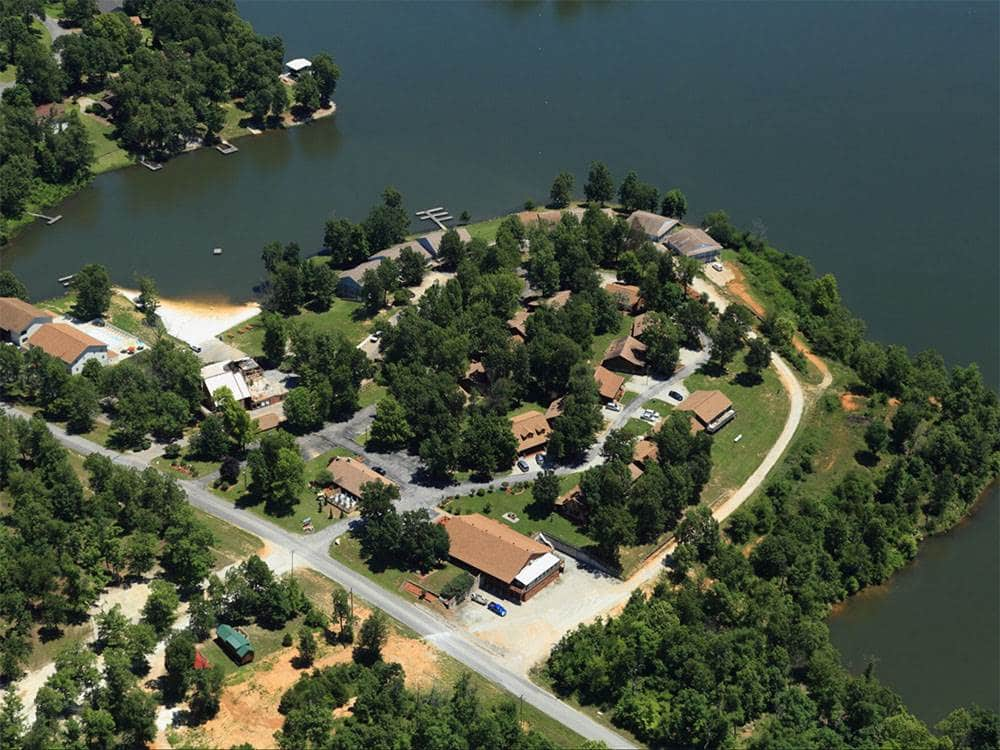 Peaceful Lakeside Retreat —Aerial view of campground on a lake.