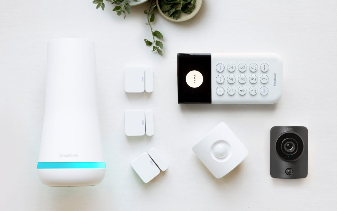 SimpliSafe theft monitoring system with keypad on white surface