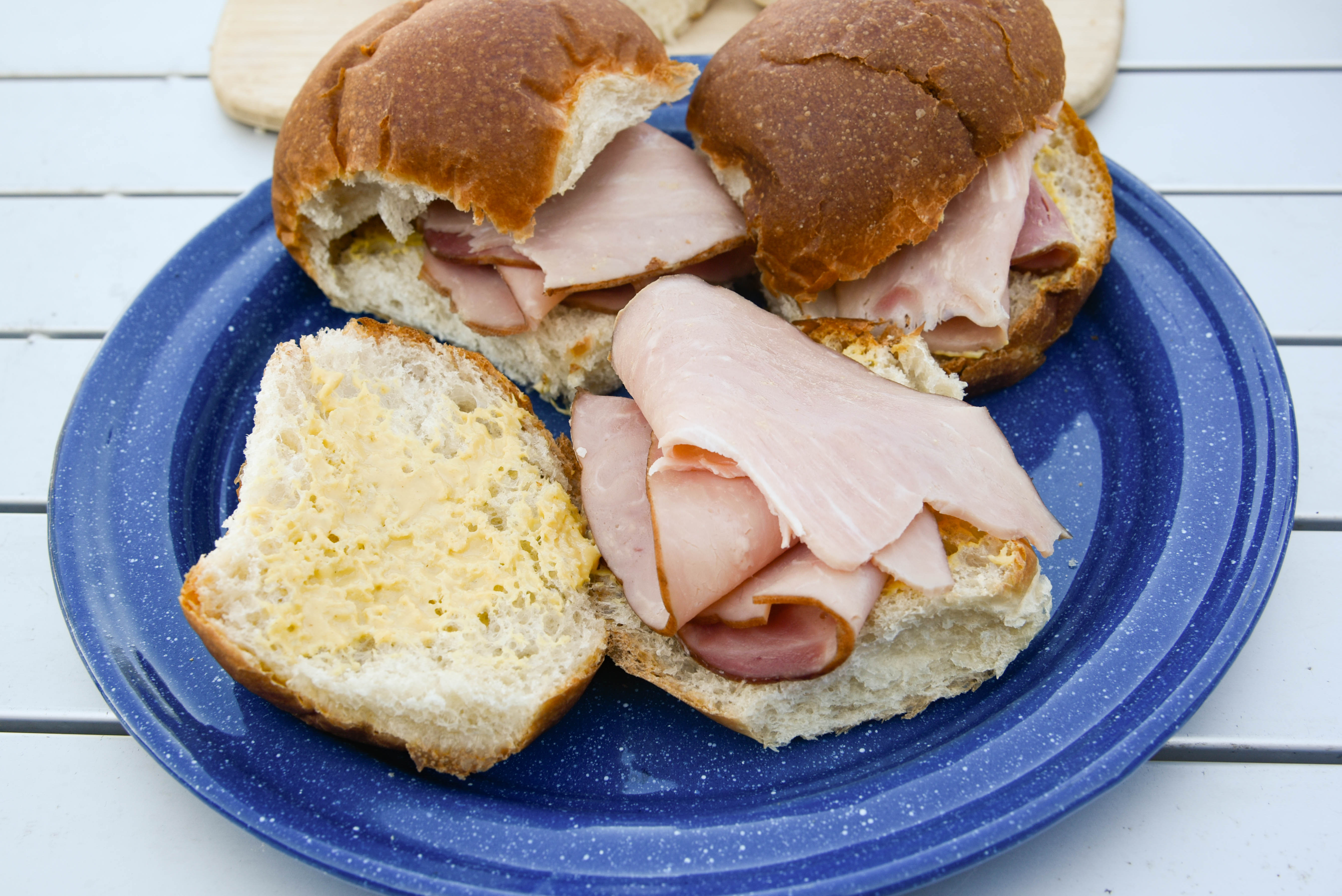 Rolls cut in half with slices of ham placed inside.