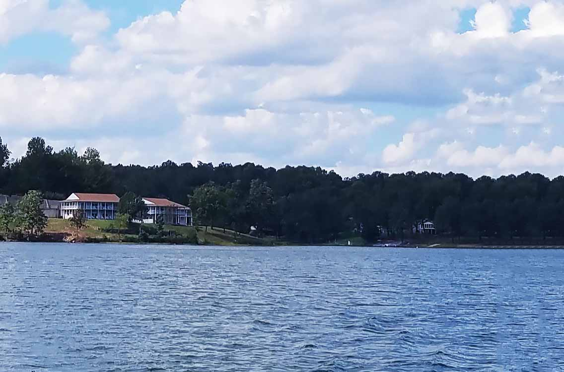Resort situated on the banks of a lake.