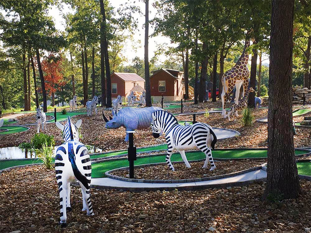 Plastic life-size African wildlife in a mini golf course.