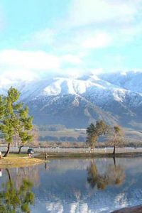 perfect getaway in San Bernardino County — mountains on the horizon reflected in a tranquil lake.
