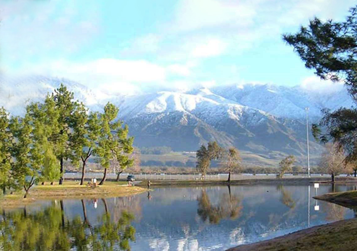 perfect getaway in San Bernardino County —mountains on the horizon reflected in a tranquil lake.