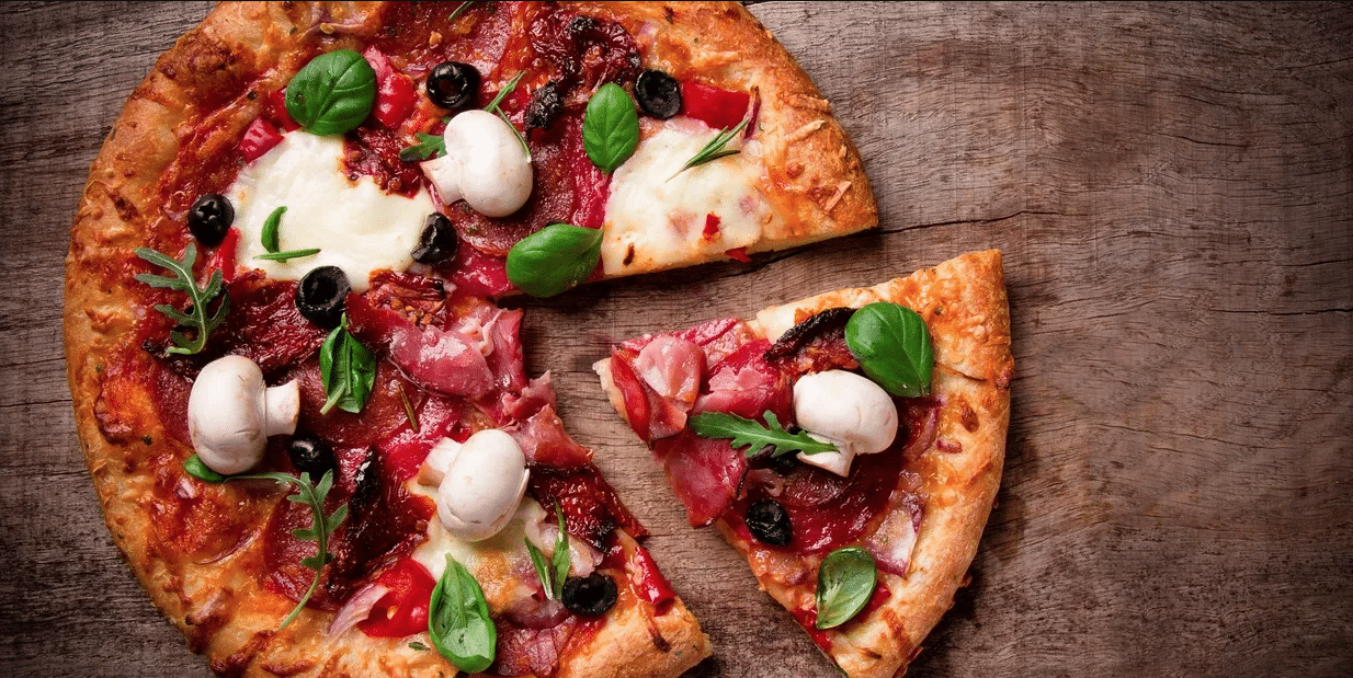 A delicious pizza with mushrooms and sun-dried tomatoes.