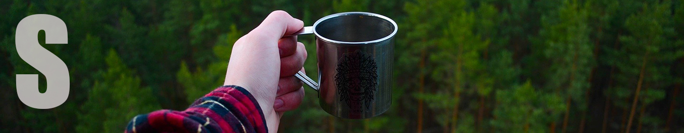 Practice good manners —A hand holds out a cup against a lush forest background.