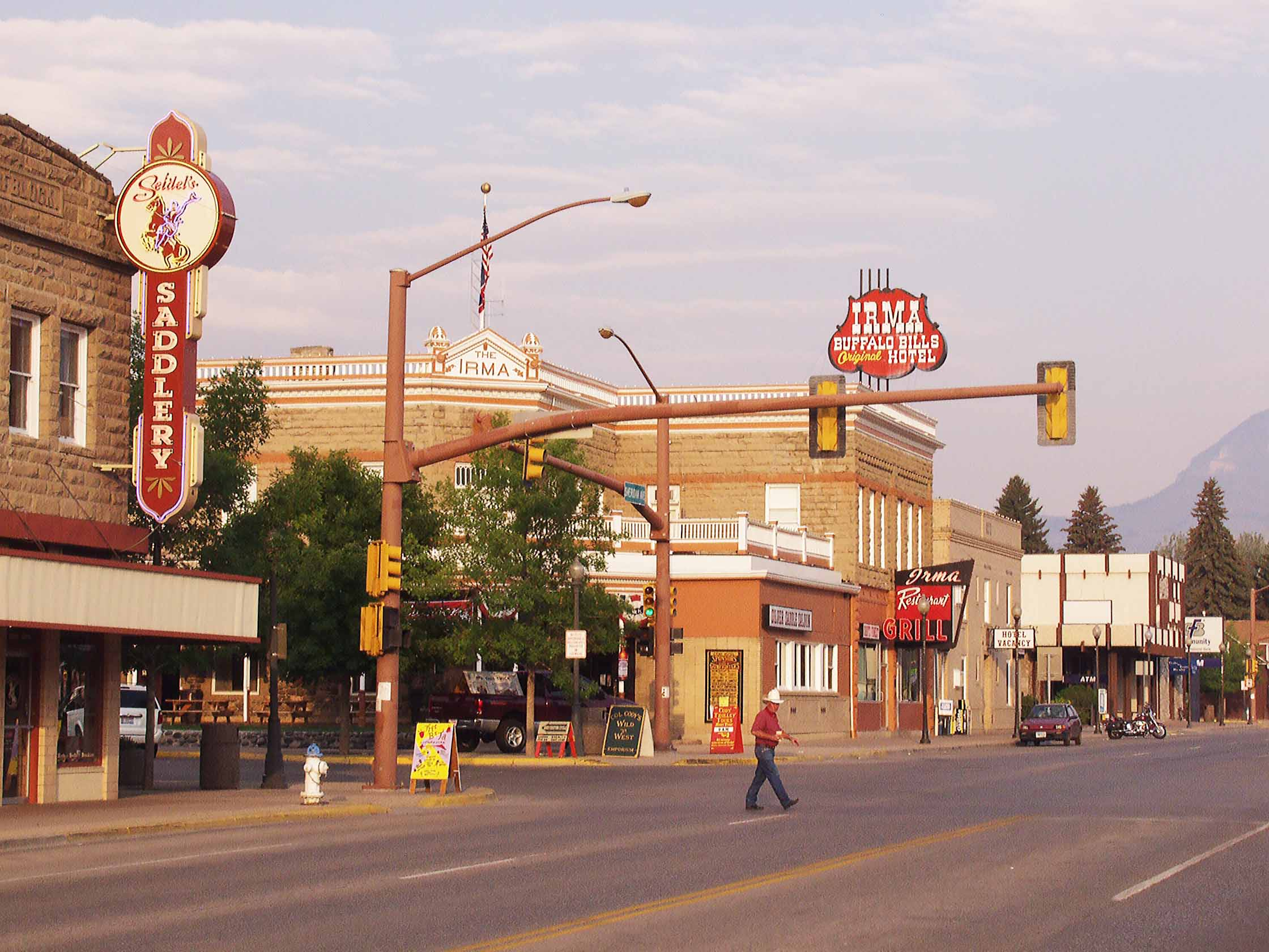 discovering Cody Yellowstone CountryA man crosses the street of an Old West town.