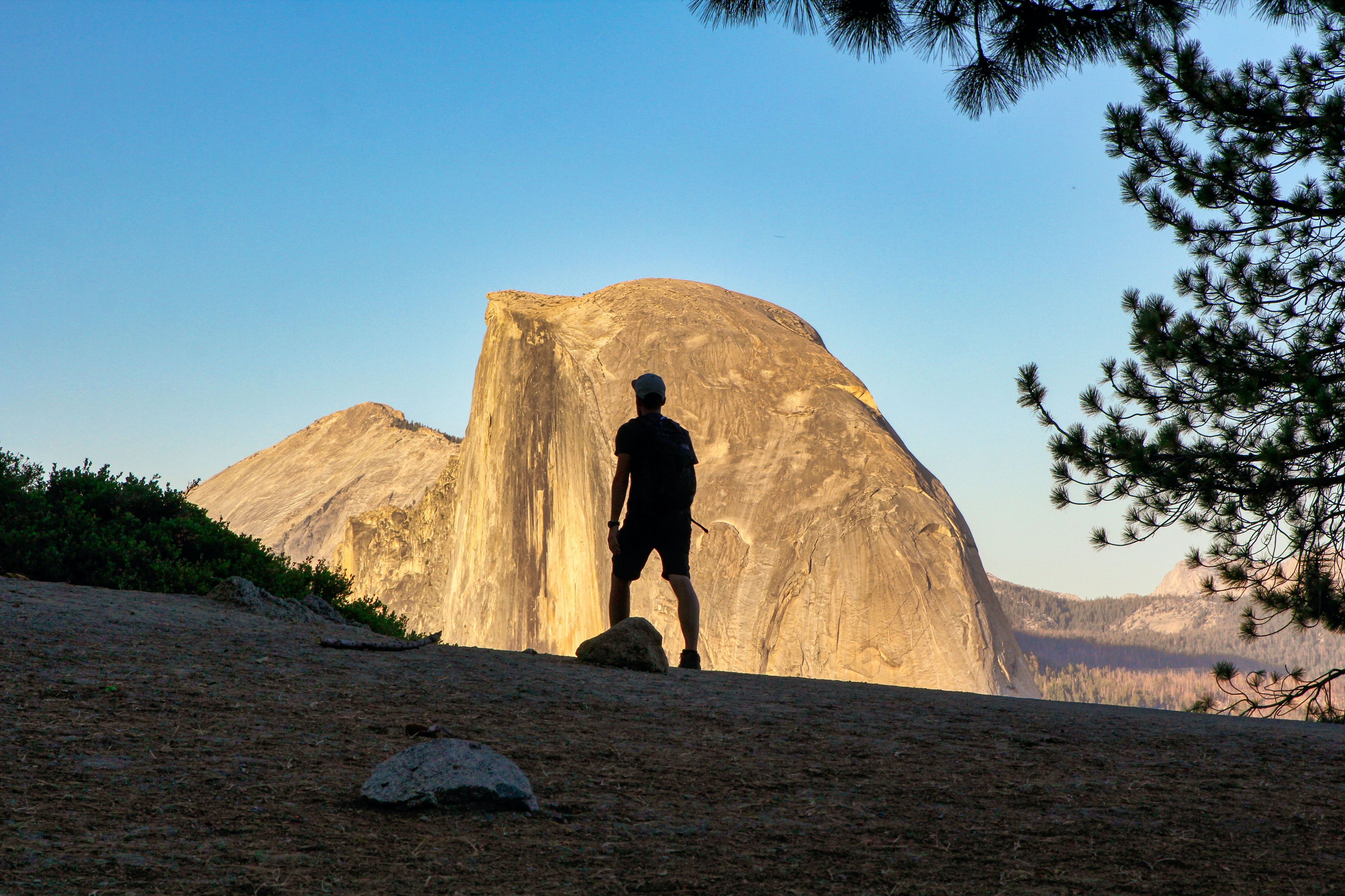 magnificent public lands in Northern California — a hiker surveys a magnificent dome-shaped peak.