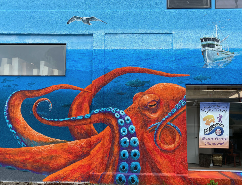 Mural of an octopus on the wall of a building.