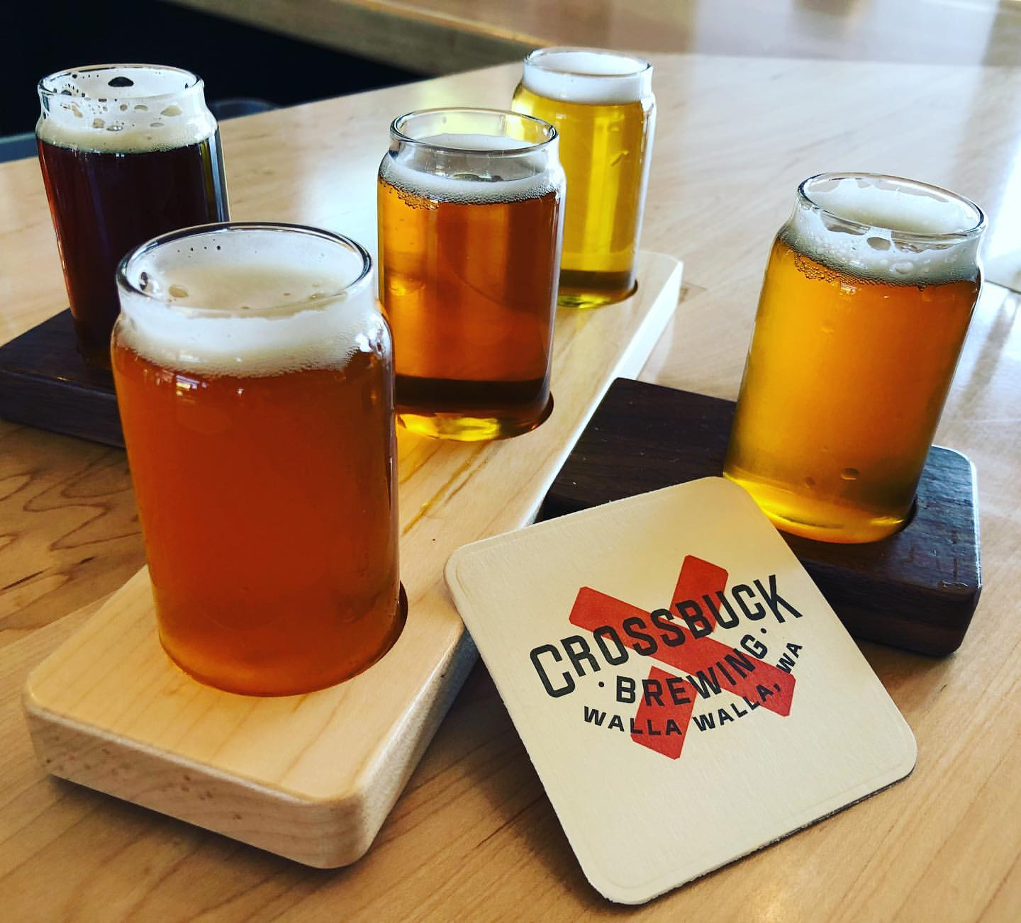 Beers arrayed in a cross-shaped serving tray.