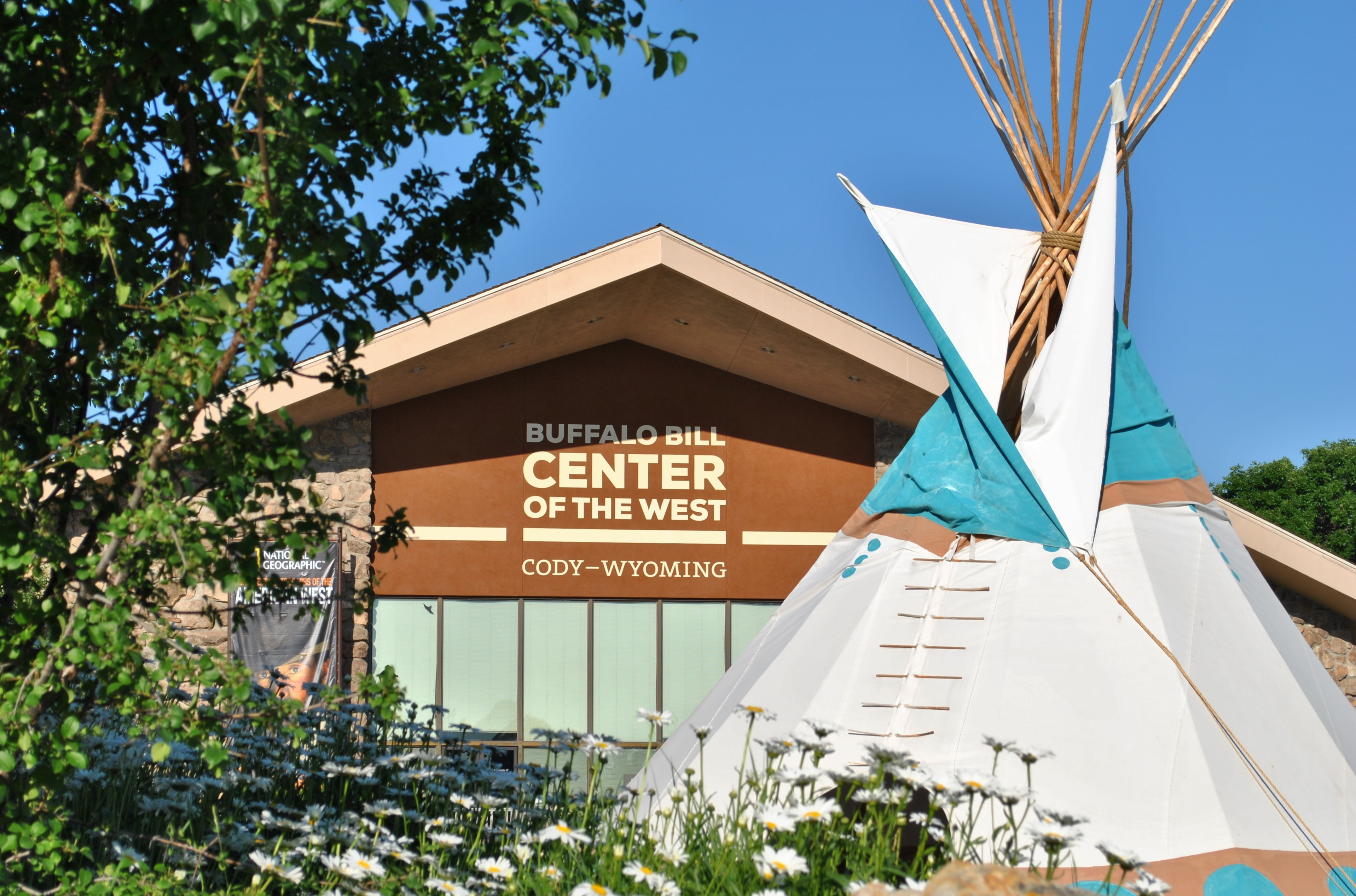 Cody Yellowstone — An a-framed museum with tepee in the background.