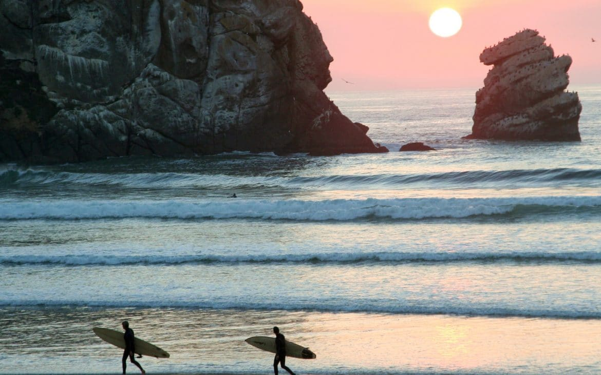 Surfers packing it up at Morro Bay, California.