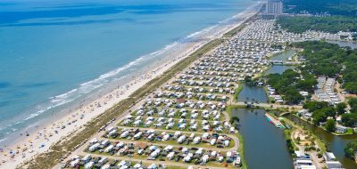 Camping Capital of the World —arial view of RVs parked on coast.