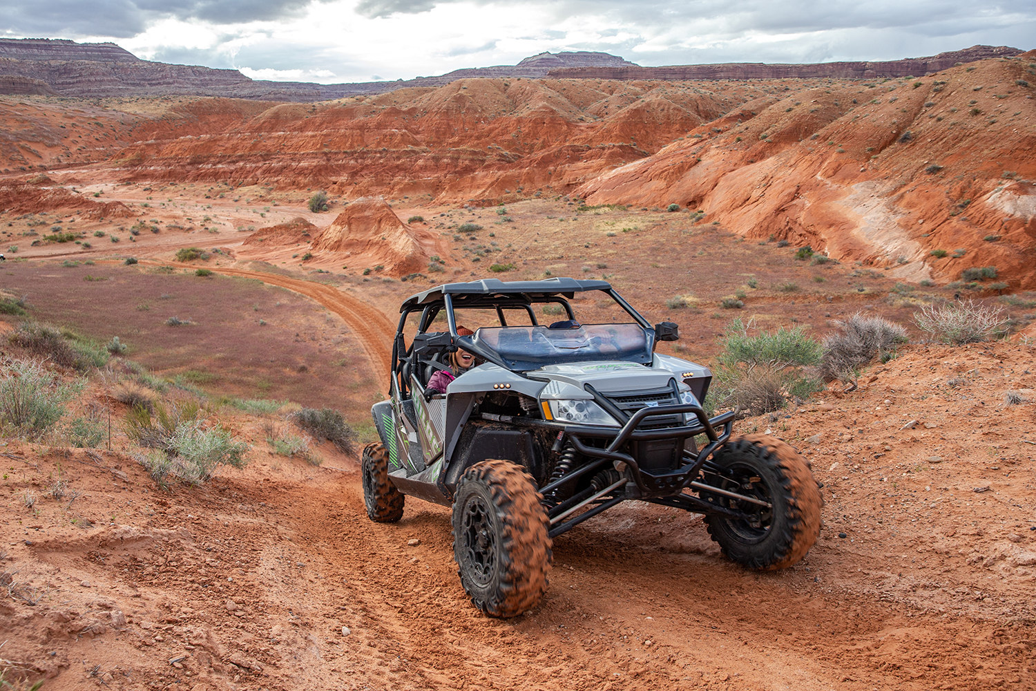 An atv trundles across an offroad trail.