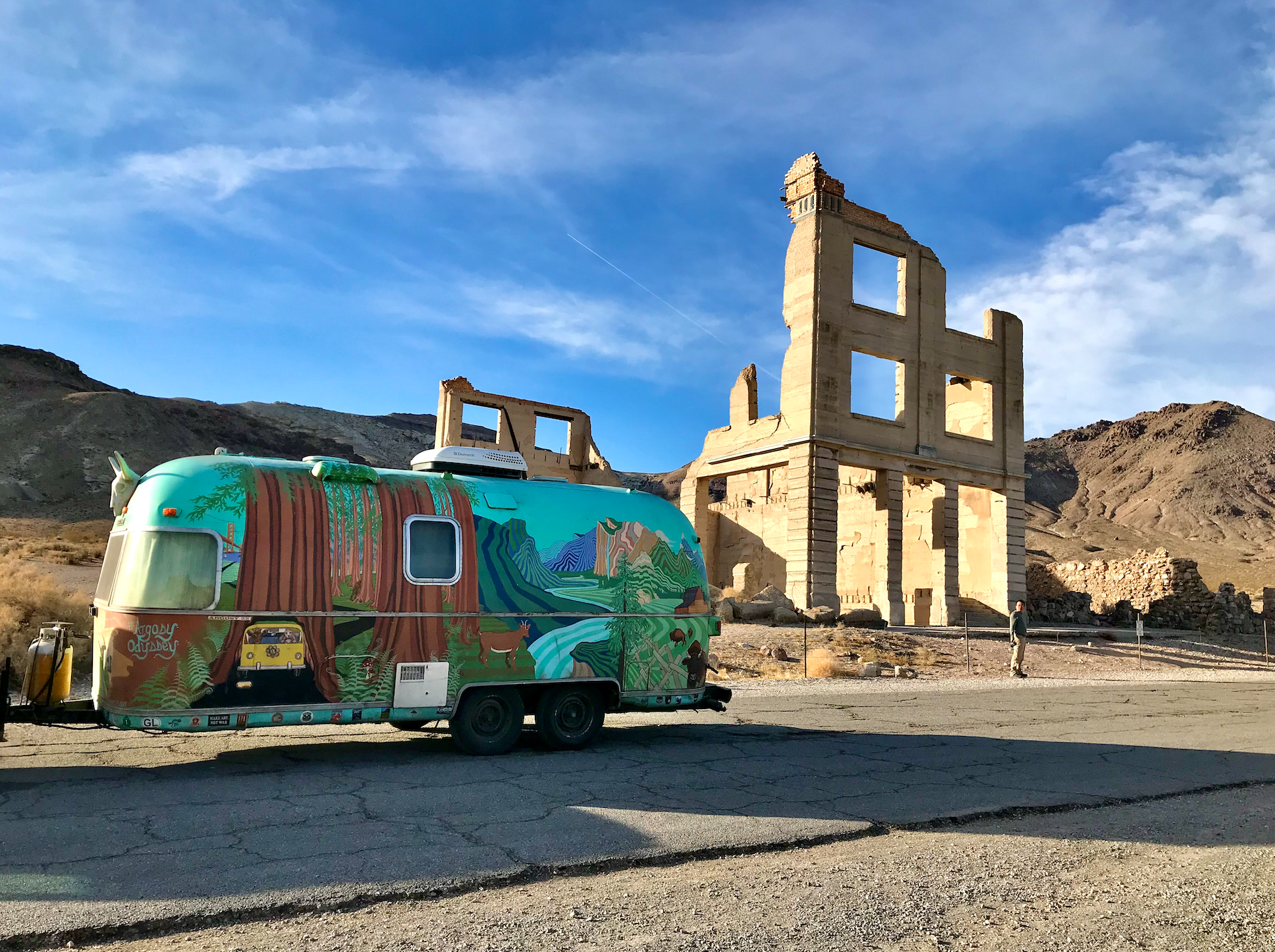 painted airstream in front of Cook Bank, the tallest building in Rhyolite.