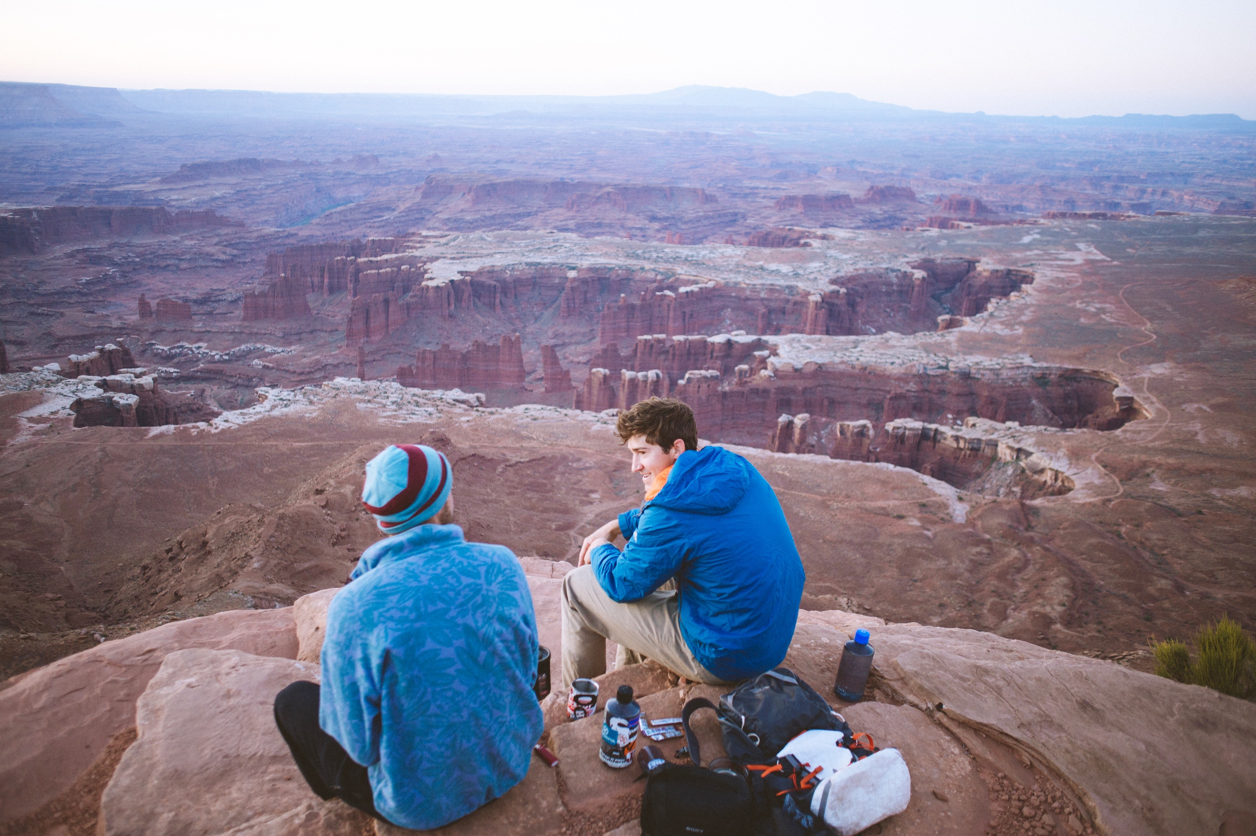 Relaxing atop a peak overlooking craggy canyons