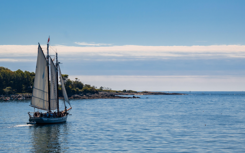 A sailboat heading toward the ocean.