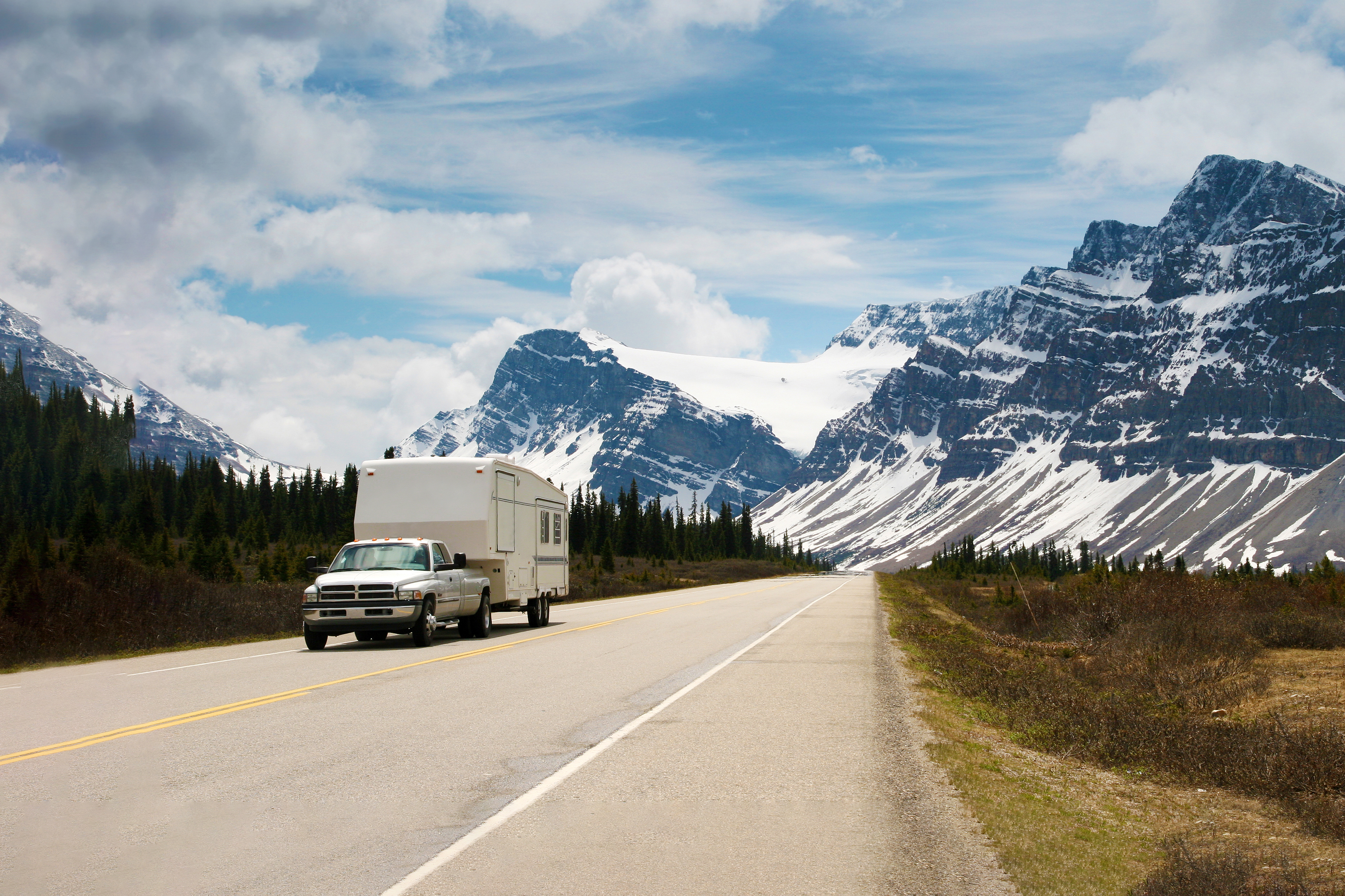 Summer of RVing — fifth-wheel rolling down a highway.
