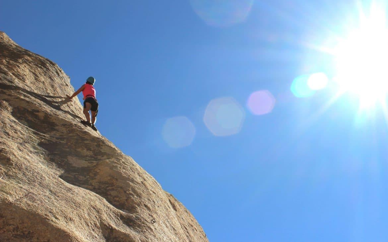 Woman rock climbing at Joshua Tree National Park.
