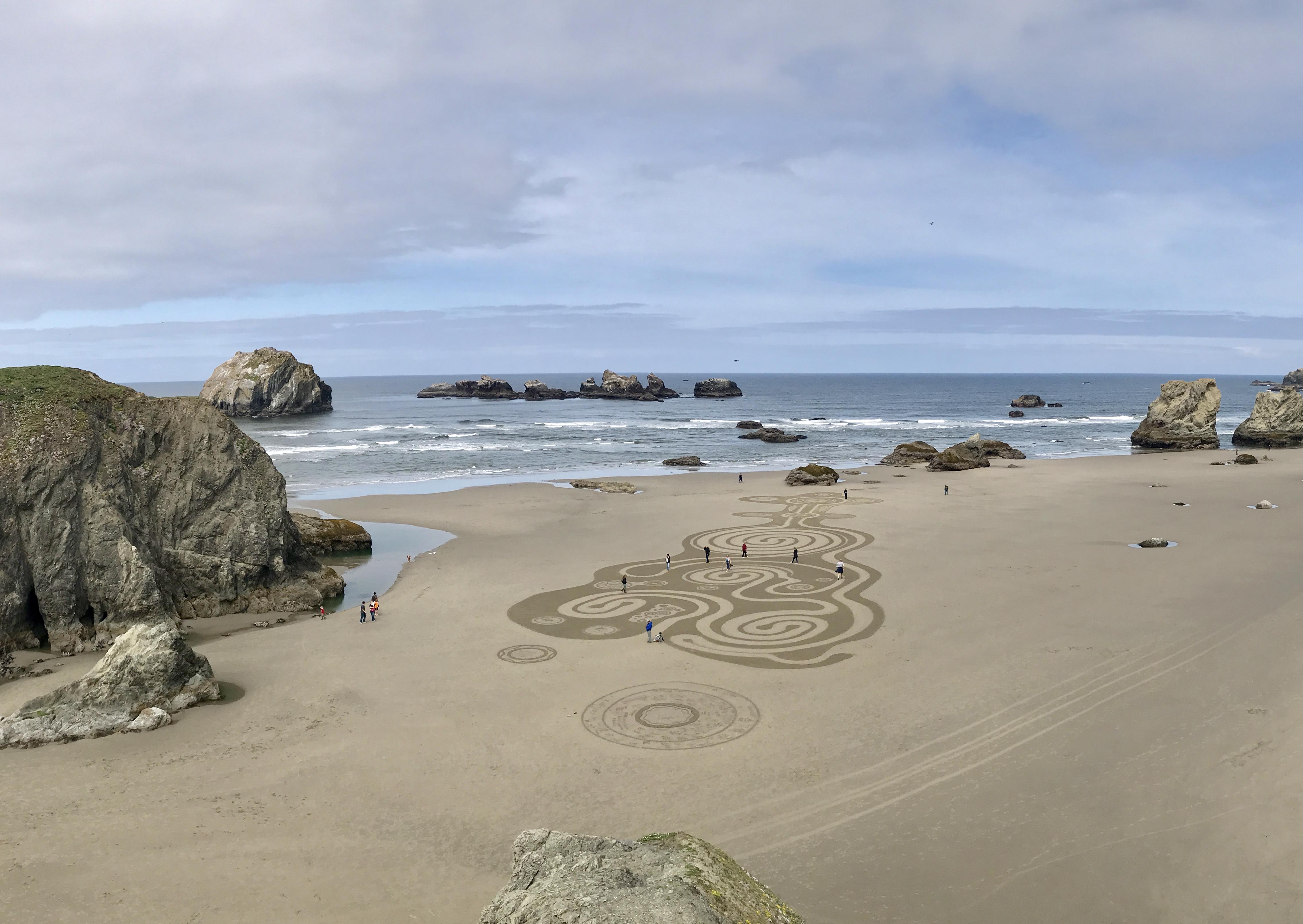 Circles drawn into the sand at a beach.