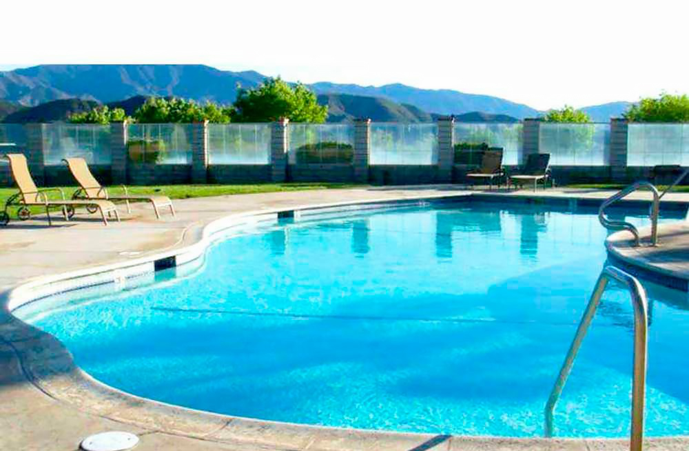More Great Camping Experiences — Swimming pool sparkling under the sunlight.