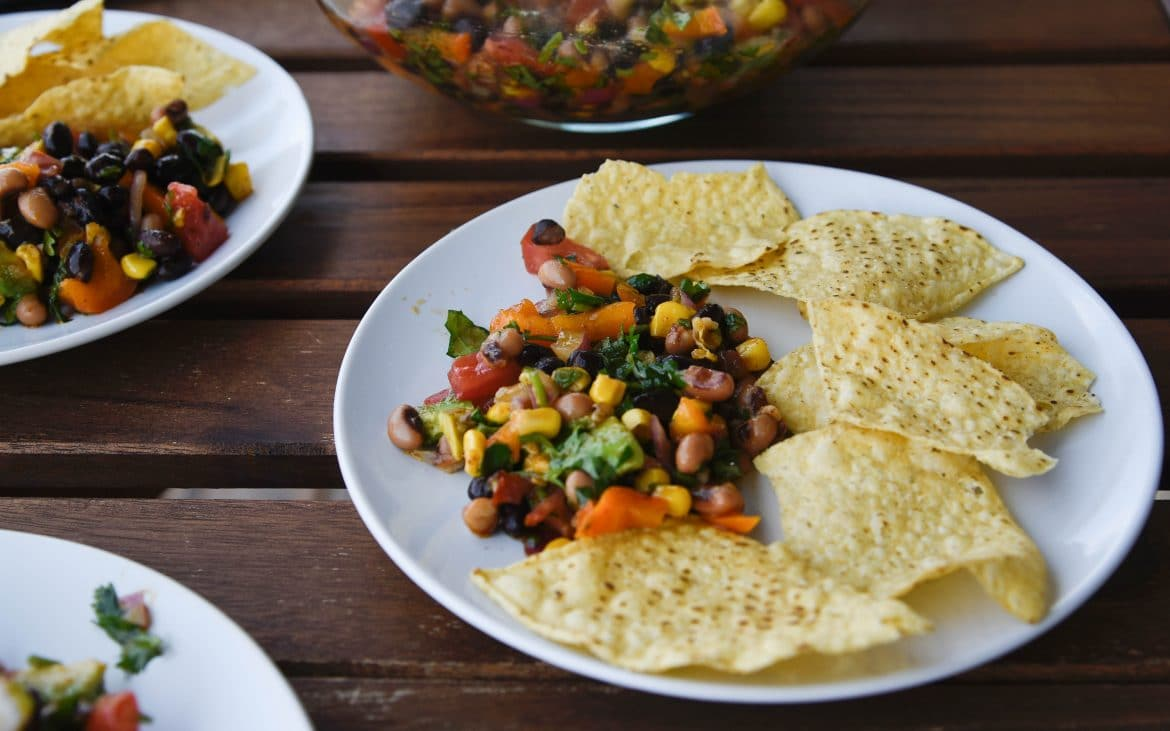 Cowboy caviar on plate with chips