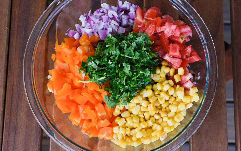 Colorful mixture of cilantro, onion, tomato in bowl