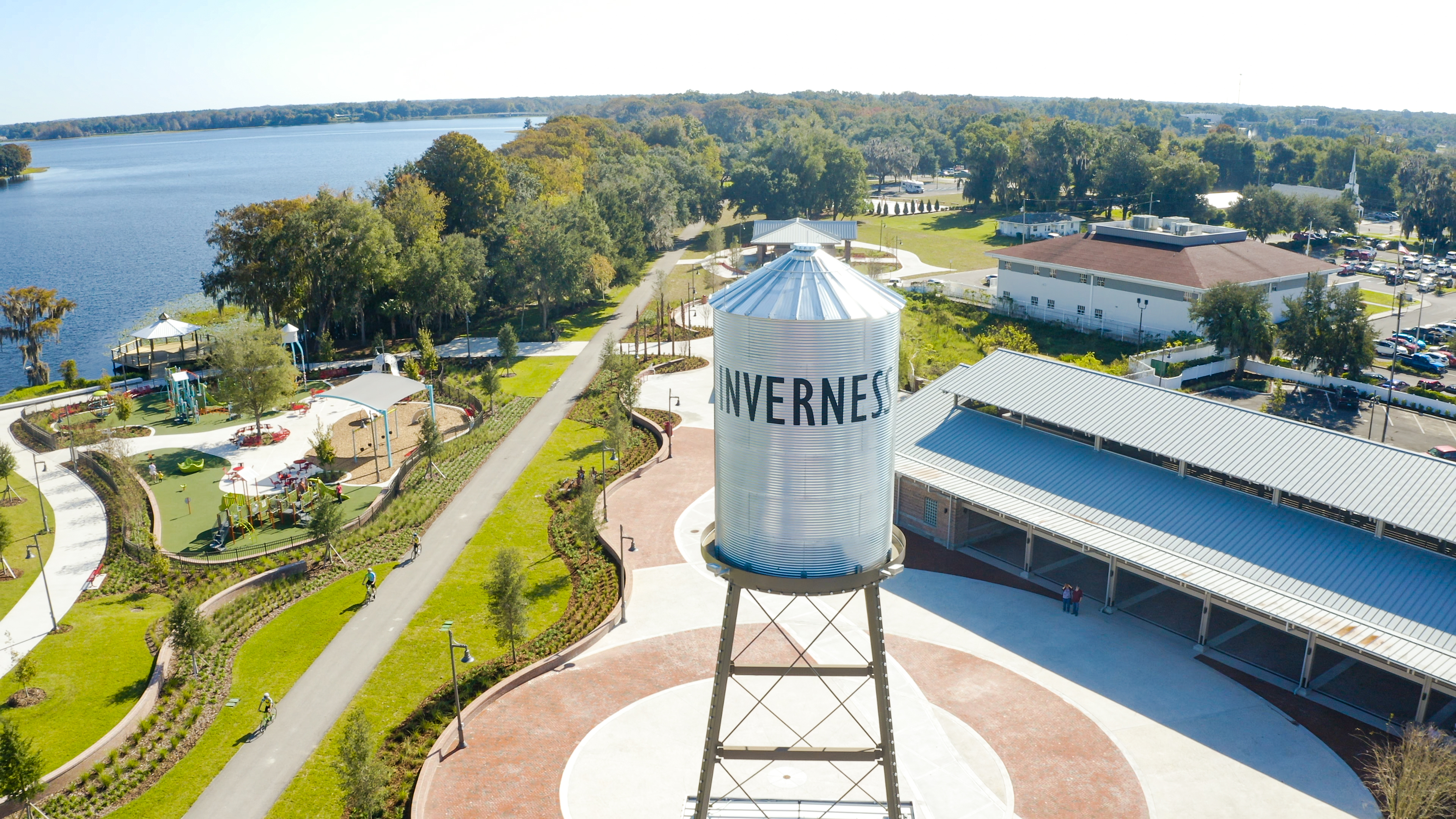A silver water tower rises above a town.