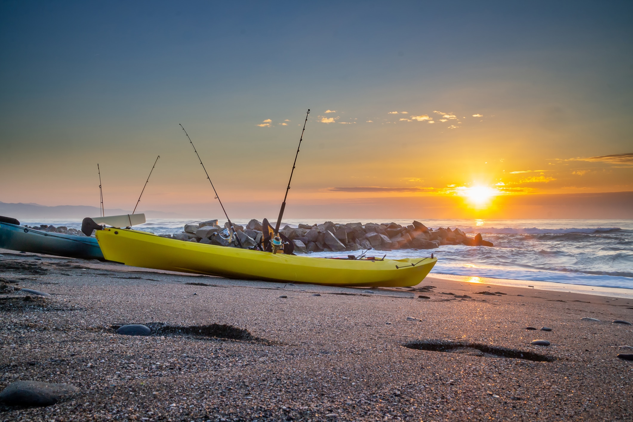 Two kayak on the beach waiting to fish - kayak fishing competition in the Mediterranean Sea - Marbella. Andalusia